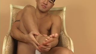 asian go-go boy rubs his sore feet