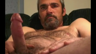 handsome silver daddy jerks his cock