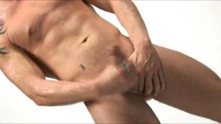 Gay pornstar beats his meat