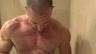 Rough muscle man showers off