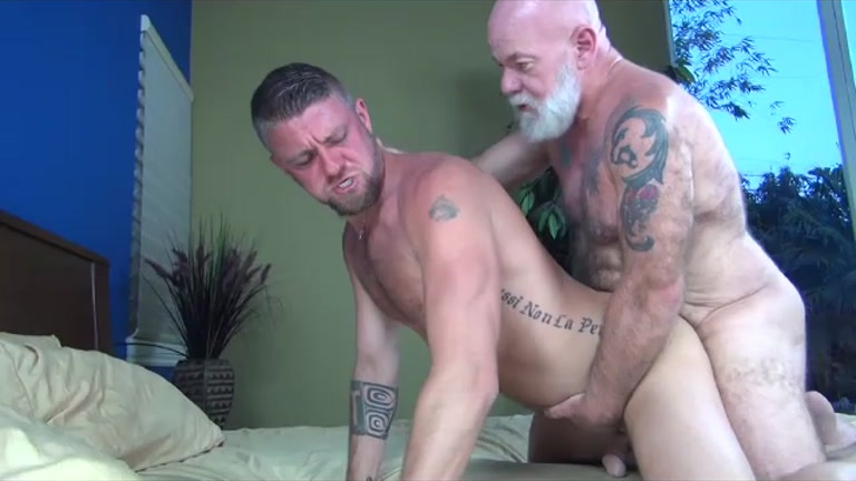 bearded silver daddy fucks his boy .