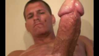 redneck with a tattooed belly strokes his big cock