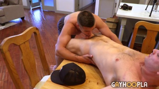 guy lays across dining room table & gets his dick sucked