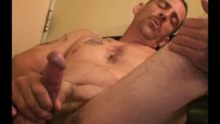 redneck with mustache strokes his big-nobbed dick