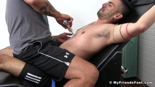 puerto rican guy strapped into tickling chair