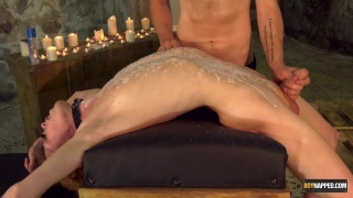 slave boy tied across a bench gets his hole stretched