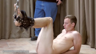 young straight lad is suspended for a spanking session