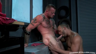 muscle hunks suck each other's cocks in a workshop