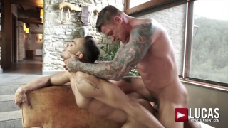 inked muscle stud gives a guy a rough fuck over the couch