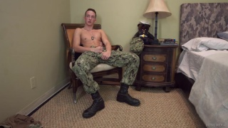 guy in camouflage pants & boot jacking off