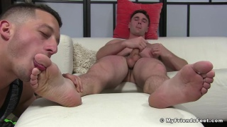 guy jerks his cock while a dude worships his size 11 feet