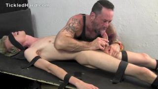 strapped down, blond guy gets tickled them sucked off