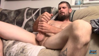 bearded thug double fists his sizable cock