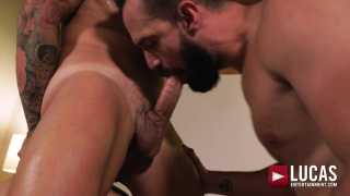 bottom moans while two men go balls deep on his ass
