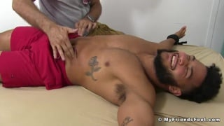 swarthy bearded hunk tied down & tickled