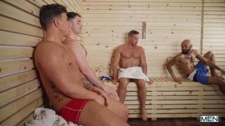 three men suck & fuck in sauna while a man sleeps