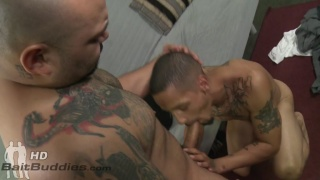 slim guy fucks a heavily inked bald latino man