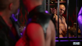 leather daddies fuck & fist a horny young lad in a bar