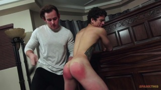 beefy guy spanks guy's pretty ass til it's bright red