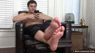 Sexy Hunk Pulls Off Boots & Airs Out His Feet While Watching Porn