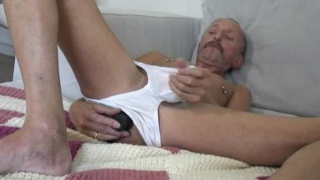 daddy with a dildo stroking his cock