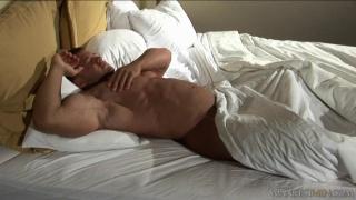 Bodybuilder in his bed