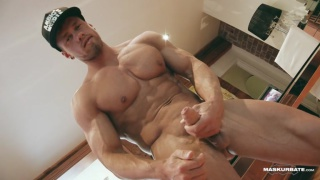 ripped muscle hunk in baseball cap jerks his hard cock