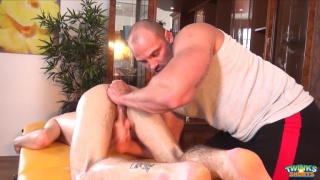 muscle hunk makes young guy cum on his own face