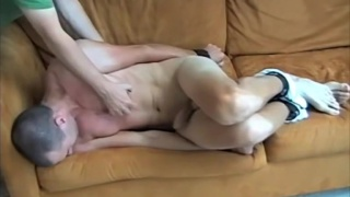 bound naked guy tickled on the couch