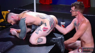 muscle daddy fists a heavily inked stud's ass