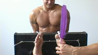 stripper gets his feet tickled by two men