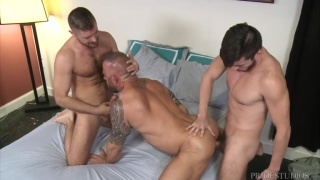 two younger guys spit-roast fuck an older man