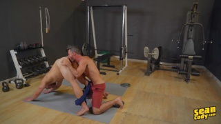handsome yoga instructor fucks a guy in a downward dog position