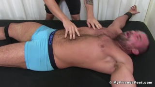 hairy muscle hunk tied down & tickled by his lover