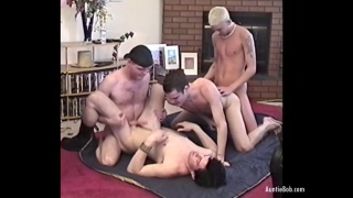 four young lads have an orgy on the living room floor