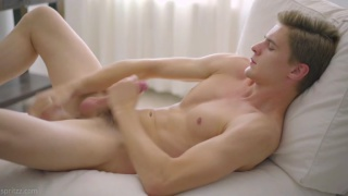 cute blond twink plays with a dildo