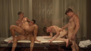 three masseurs & a client fuck on the massage table
