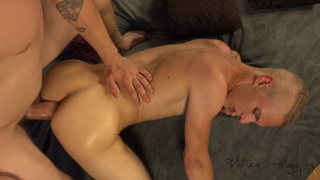 blond guy on all fours taking a huge uncut cock