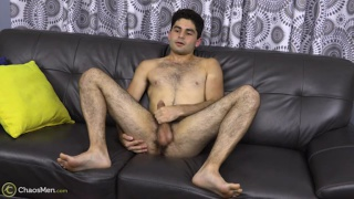 athletic guy with dark hairy legs jacks off