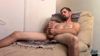 handsome straight guy with bearded strokes cock with both hands