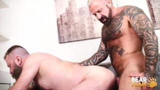 heavily inked muscle bear fucks a bear man with a belly