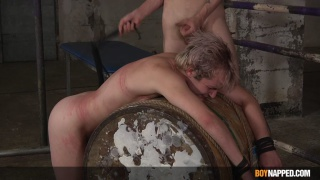 naked twink roped over a barrel & beaten