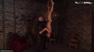 master suspends his slave boy upside down & sucks his cock