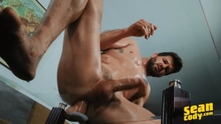 Bearded Stud Sits on a Dildo Plunged to his Coffee Table