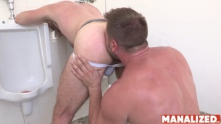 Sexy Hunk Gets Rimjob While Bent Over Urinal