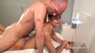 bald guy fucks a twink's ass on massage table