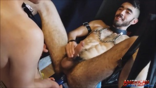 bearded guy in sling takes a number of dildos