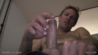 guy plays with his precum during JO video