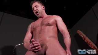 guy slides a sounding rod deep into his uncut dick