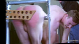 physical trainer gets his firm bum paddled
